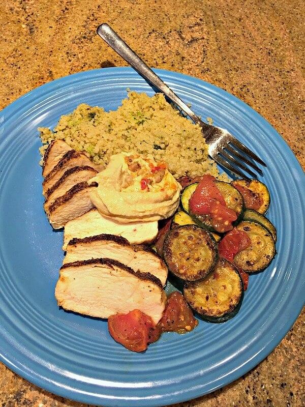 Chicken, quinoa, zucchini, tomatoes and hummus