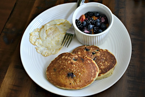 dairy-free blueberry pancakes along with a fried egg and fresh farmers market fruit