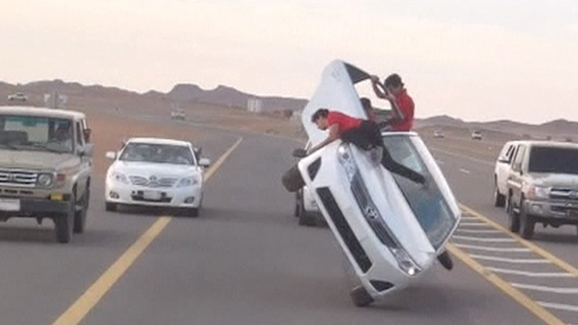 Car surfing in Saudi. Photo: The guardian