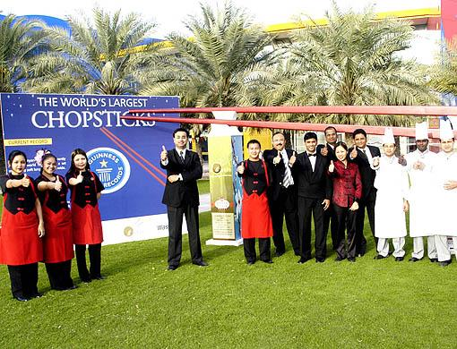 Management and staff of Chopstix, Dubai, with their really big chopsticks. Photo: Gulfnews.com