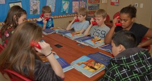 Fourth-graders at Central Manor practice reading with Whisper Phones