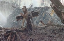 The World Trade Center cross, as it stood after the smoke and debris cleared enough to see it on September 11, 2001.