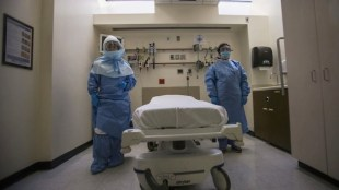 Oct. 8, 2014: Health care workers display protective gear, which hospital staff would wear to protect them from an Ebola virus infection, inside an isolation room as part of a media tour in the emergency department of Bellevue Hospital in Manhattan, New York. (Photo: Reuters)