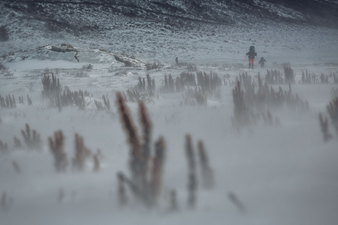 Rebecca Watters and Forrest McCarthy ski through shallow snow on a blustery afternoon.