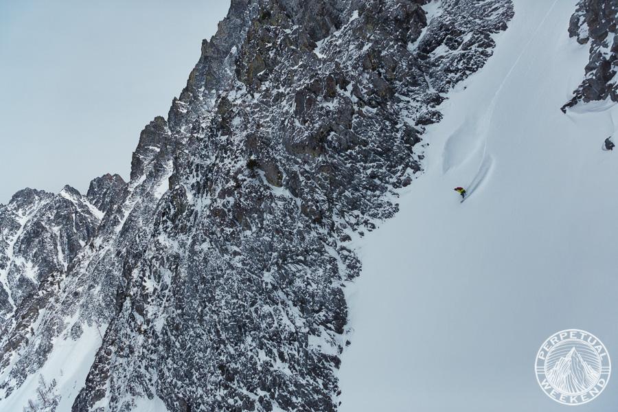 Neil Provo dropping into a chute above Holden Village, Cascades, Washington
