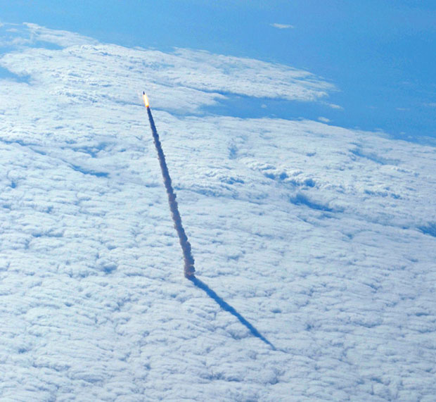 Space Shuttle Endeavour Rises Above the Cloud Deck shuttle