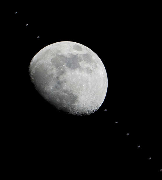 Photographer in Parking Lot Captures ISS Passing In Front of the Moon issmoon mini