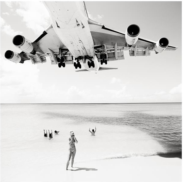 Photographs of Airplanes Hovering Over the Heads of Sunbathers airliner1 mini