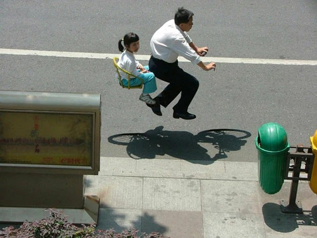 Chinese Commuters Floating on Invisible Bicycles bike1 mini