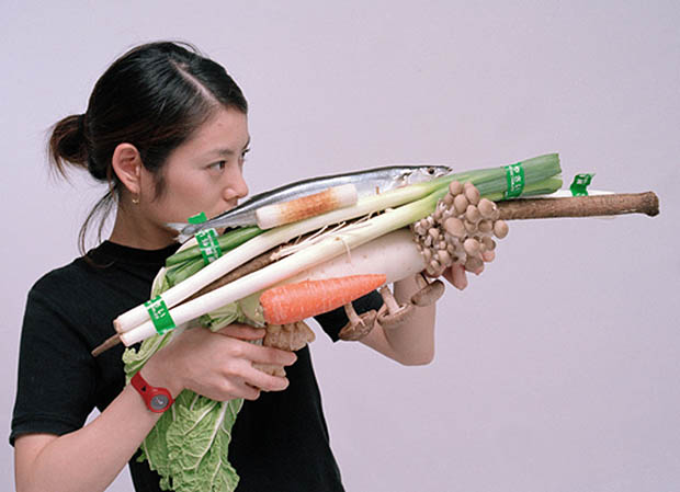 Photos of Women Holding Vegetables as Weapons veggun3