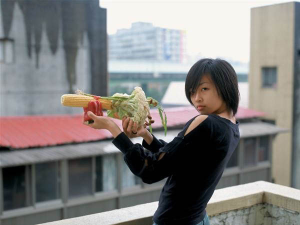 Photos of Women Holding Vegetables as Weapons veggun4