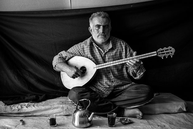 Portraits of Refugees Posing With Their Most Valued Possessions syria 1 copy
