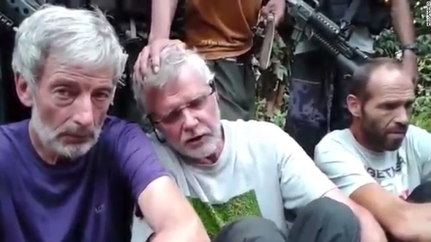 Canadians Robert Hall (left) and John Ridsdel (centre) were beheaded earlier this year. The third  hostage, Norwegian Kjartan Sekkingstad, was freed by the Abu Sayyaf on September 17.