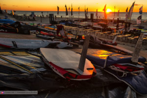 Sunset in Sylt, Germany with a pile of windsurf gear on the beach