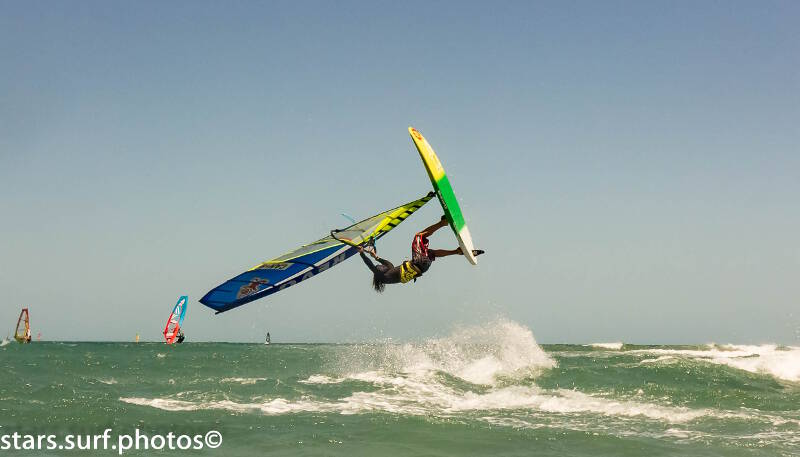 Phil Soltysiak windsurfing and getting hungry in front of Club Ventos in Jericoacoara, Brazil. Photo by Montorfano Andrea.