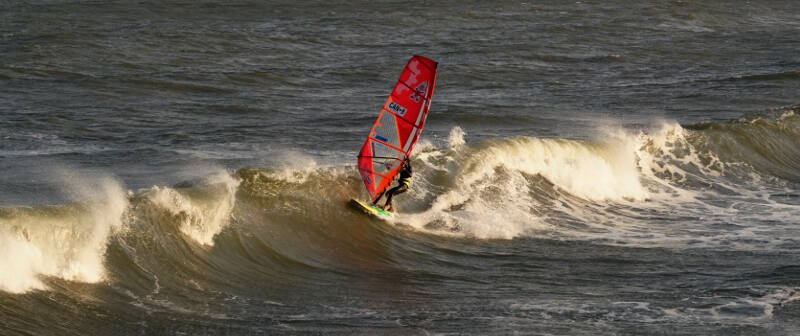 Phil Soltysiak CAN 9 windsurfing freestyle board wave riding at the Avon Pier - Photo by Adam Wojtkowiak
