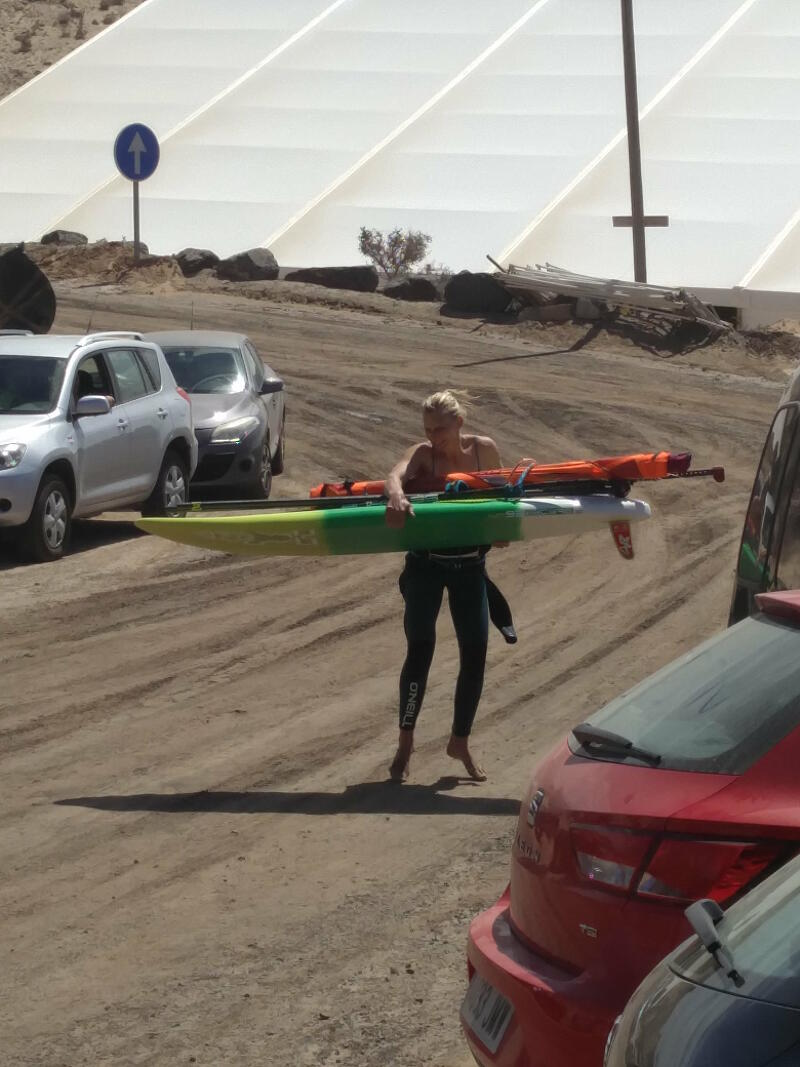 Norwegian Oda Johanne dancing for joy after a Fuerteventura windsurf session.
