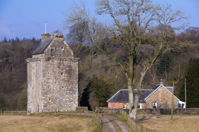 Hollows, the tower house of the Armstrong clan lairds of Gilnockie on the border between England and Scotland. Retouched image with power lines removed.