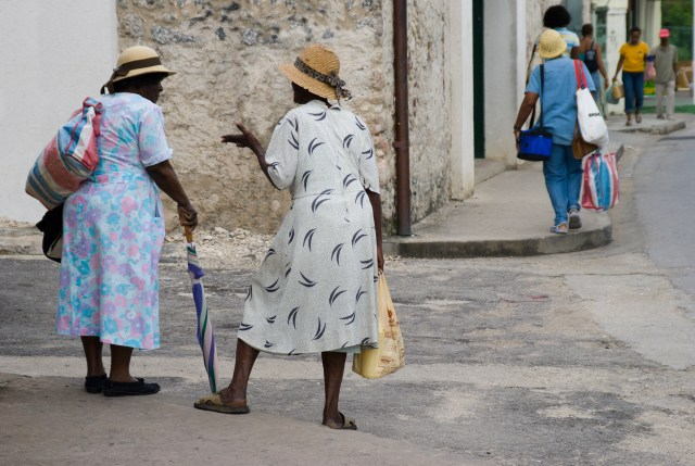 Barbados Holetown St Thomas parish west coast two Bajan ladies typically dressed chat on a street corner retouched version