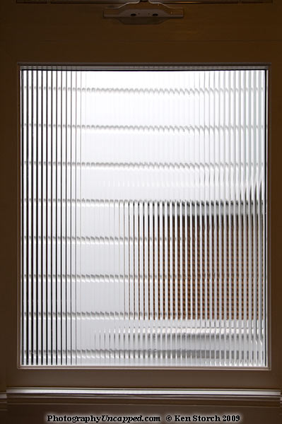 The divided patterns of light through a glass window
