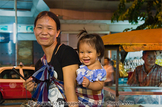 Mother and Child in the Patpong district of Bangkok Thailand