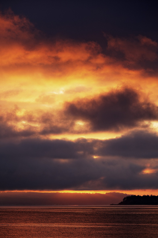 A stormy sunrise over Admiralty Inlet, Fort Worden State Park, Port Townsend, Washington, USA