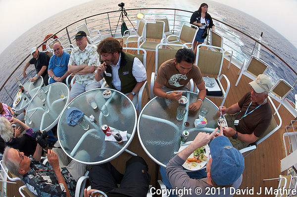 Nikonians Eating Dinner on Deck 6 of the M/V Explorer. UTW-II  2011 Spring Enrichment Voyage. Image taken with a Nikon D3s and 16 mm fisheye lens (ISO 400, 16 mm, f/5.6, 1/125 sec). Raw image processed with Capture One Pro, sharpened with Focus Magic, converted to sRGB/jpg with Photoshop CS5. (David J Mathre)