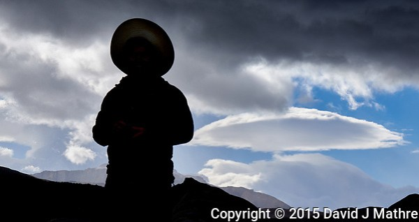 Silhouette and lenticular clouds in Patagonia. Image taken with a Fuji X-T1 camera and 55-200 mm lens (ISO 200, 55 mm, f/11, 1/250 sec). (David J Mathre)