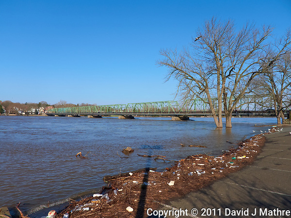 Delaware river after late winter flooding with the New Hope. PA and Lambertville, NJ bridge in the background. Image take with a Leica D-Lux 5 camera (ISO 100, 5 mm, f/4, 1/1000 sec). (David J Mathre)