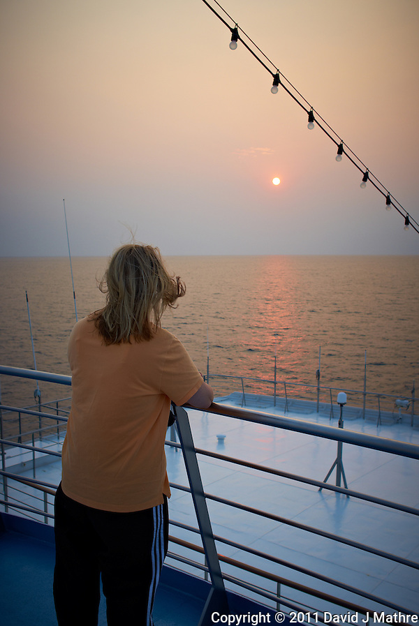 Jenny Shooting Sunrise on the M/V Explorer. Image taken with a Leica X1 (ISO 100, 24 mm, f/5, 1/250 sec) Raw image processed with Capture One Pro 6, Focus Magic, and converted to JPG/sRGB with Photoshop CS5. (David J Mathre)