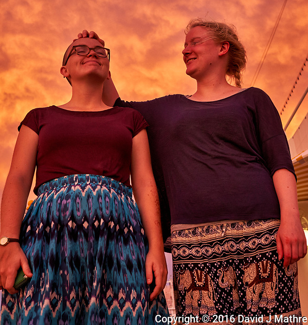 Maria and Charlette at dawn. The sky was really that color. From the aft deck of the MV World Odyssey. Day 65 of 103 of the Semester at Sea Spring 2016 Voyage at sea between Mauritius and South Africa. Image taken with a Fuji X-T1 camera and 23 mm f/1.4 lens (ISO 800, 23 mm, f/4.5, 1/60 sec) (David J Mathre)