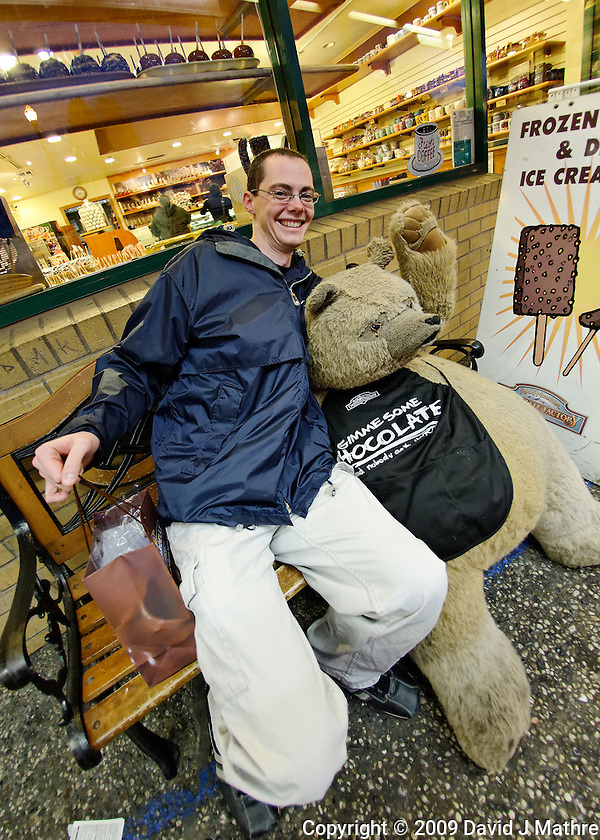 Andrew with the Gimme Some Chocolate Bear in front of Ghirardelli Chocolate Shop in San Francisco. Image taken with a Nikon D700 and 16 mm f/2.8 fisheye lens (ISO 1600, 16 mm, f/2.8, 1/60 sec). Raw image processed with DxO Optics Pro, Focus Magic, Nik Define, and Photoshop CS5. (David J Mathre)