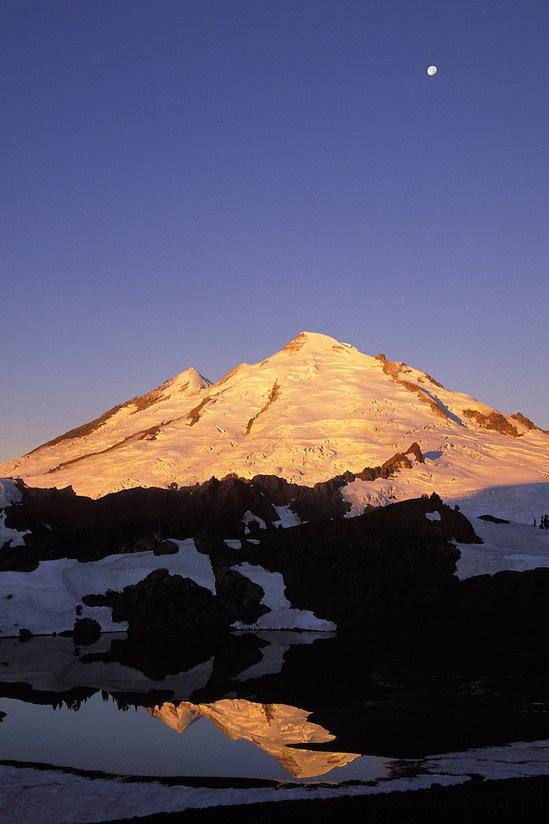Moon above Mt Baker reflected in 14-Goat Lake at sunrise, North Cascade Mountains, Washington