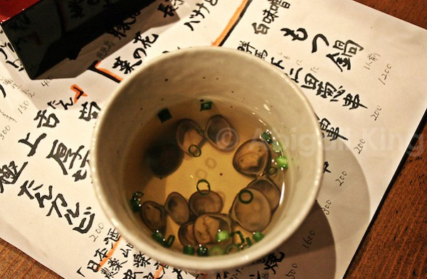 Clear soup with miniature shellfish