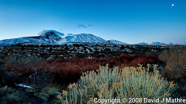Sleeping Ute Mountain and moon panorama on an early winter morning at Kelley's Place near Cortez, Colorado. Image taken with a Nikon D3 camera and 14-24 mm f/2.8 lens (ISO 200, 20 mm, f/16, 1/1.7 sec). (David J Mathre)