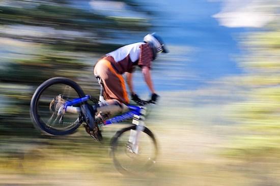 Rider performs a stoppy on mountain bike, Alberta, Canada (Brad Mitchell)