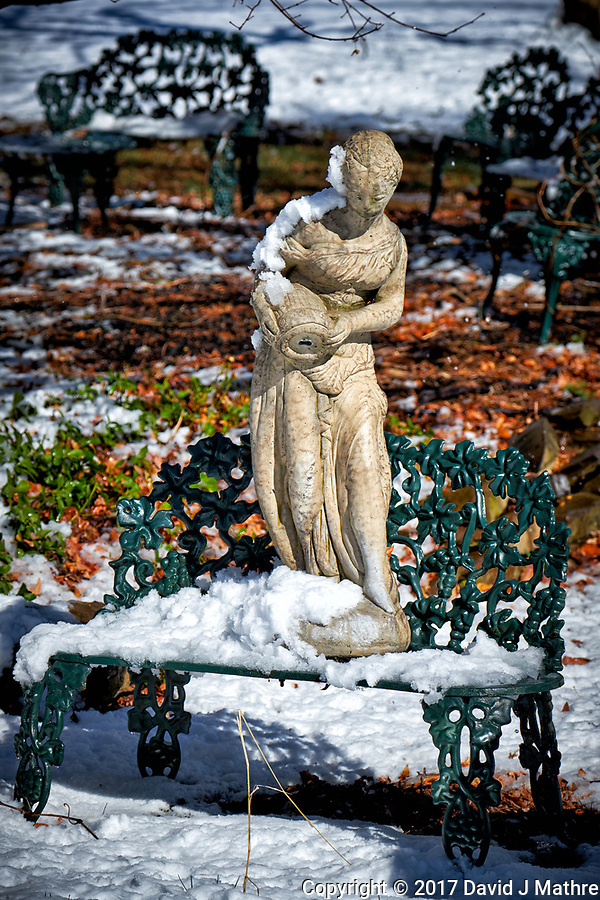 Fountain statue after a winter snowstorm. Image taken with a Fuji X-T2 camera and 100-400 mm lens (ISO 200, 100 mm, f/5.6, 1/1100 sec). (David J Mathre)