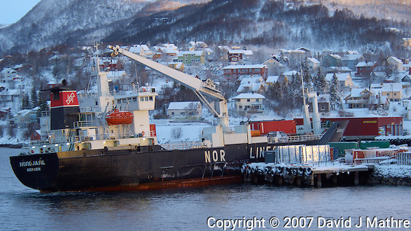 The Cargo Ship NARDJARL Listing While Unloading Containers in Finnsnes Norway. Image taken with a Nikon D2xs and 80-400 mm VR lens (ISO 200, 80 mm, f/4.5, 1/25 sec) (David J Mathre)