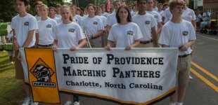 Pride of Providence Marching Band prepares to march in annual Matthews Alive parade.