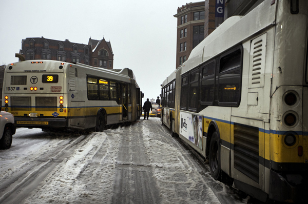 12/29/2015-Boston,MA. Two of 5 MBTA elongated buses are seen stuck during Tuesday morning's snowfall. The buses, on Clarendon St. between Columbus and St. James, were stuck for approximately one hour. Staff photo by Mark Garfinkel