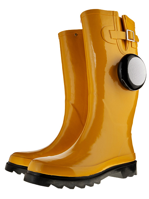 Yellow Wellington boots with a bluetooth speaker attached.