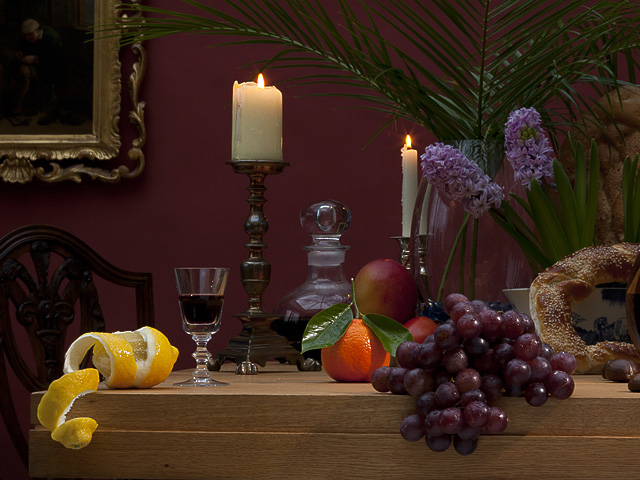 Traditional still life image of fruit and natural produce on a table.