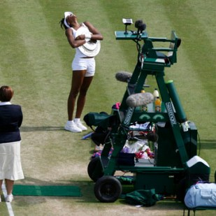Venus Williams of the U.S. celebrates after winning the final against France's Marion Bartoli at the Wimbledon tennis championships in London, July 7, 2007.