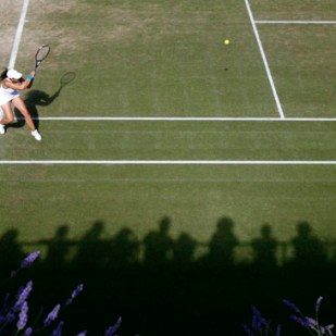 France's Marion Bartoli plays a return during her singles match against Israel's Shahar Peer at the Wimbledon tennis championships in London, June 29, 2007.