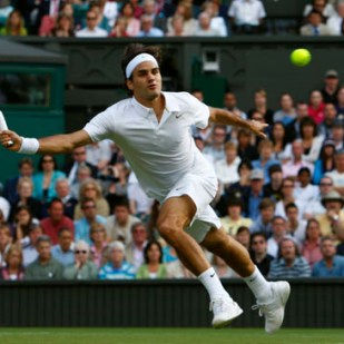 Roger Federer of Switzerland reaches for the ball during his match against Robin Soderling of Sweden at the Wimbledon tennis championships in London June 25, 2008.
