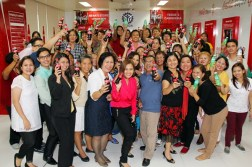 WOMEN REACH! graduates, together with TESDA and Coca-Cola officials, celebrate the conclusion of their 12-week micro-entrepreneurship skills training. At the center are Coca-Cola Sustainability Manager Gilda Maquilan and Labor Undersecretary Nicon Fameronag.