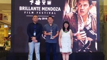 (left to right) Assistant Mall Manager Matthew Mark De Guzman, Director Brillante Ma Mendoza, and SM SVP for marketing Millie Dizon