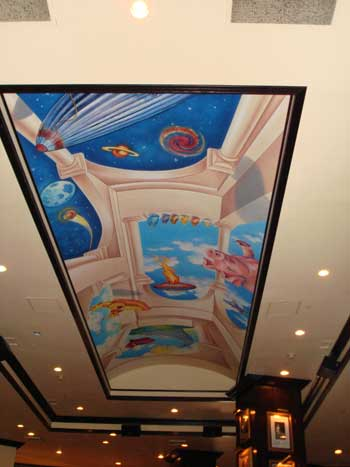 DMFLOYD strikes again. Our roving Hard Rock/Pink Floyd major contributor snapped the ceiling above at the Philly Hard Rock Cafe in June 2007. Astute observers will no doubt spot the pig. DMFLOYD tells us that currently Washington DC, Louisville KY, and Las Vegas NV have ZERO Floyd items on display.