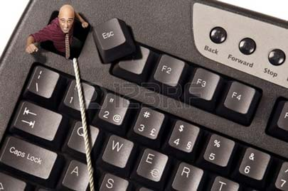 businessman-escaping-from-escape-key-in-a-computer-keyboard