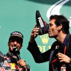Mark Webber drinks from Daniel Ricciardo's shoe